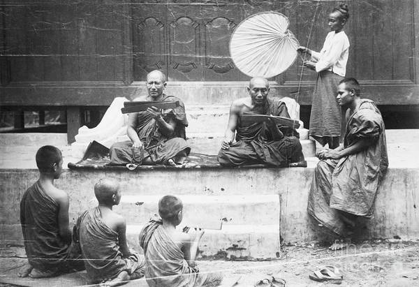 Education Art Print featuring the photograph Buddhist Monks Teaching Law From Palm by Bettmann