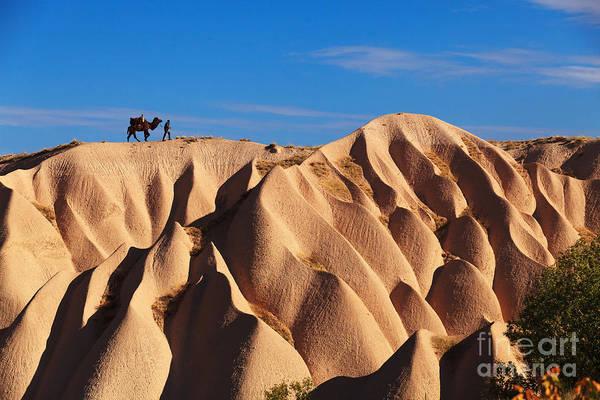 Kapadokya Art Print featuring the photograph Camel And The Cameleer On The Rock by Yavuz Sariyildiz