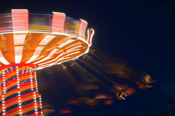 Blurred Motion Art Print featuring the photograph Carnival Ride by By Ken Ilio