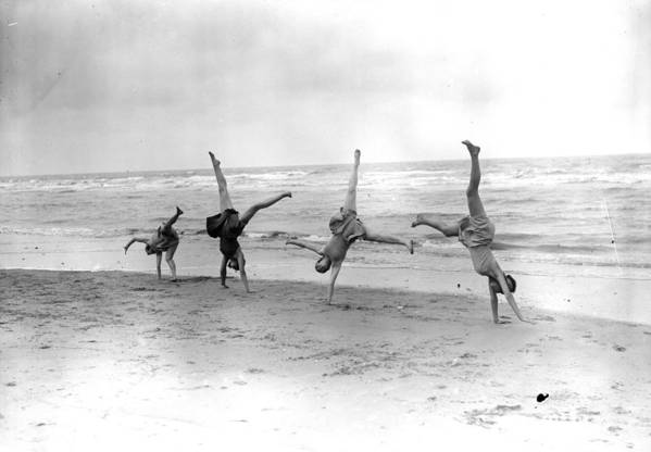 People Art Print featuring the photograph Cartwheels by Fox Photos