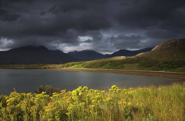 Tranquility Art Print featuring the photograph Dark Storm Clouds Hang Over The by John Short / Design Pics