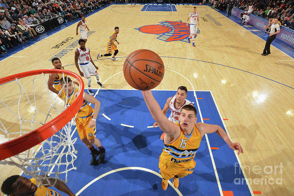 Nba Pro Basketball Art Print featuring the photograph Denver Nuggets V New York Knicks by Jesse D. Garrabrant