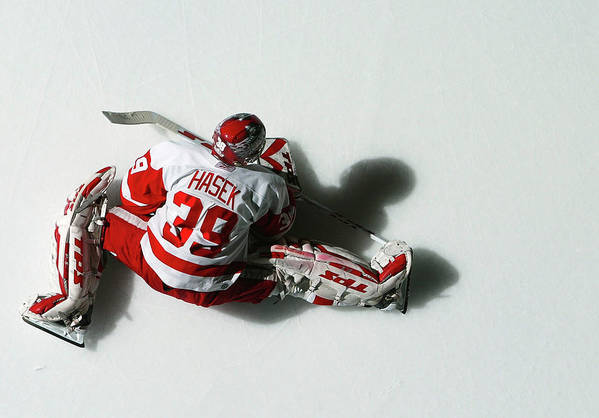 National Hockey League Art Print featuring the photograph Detroit Red Wings V New York Islanders by Al Bello
