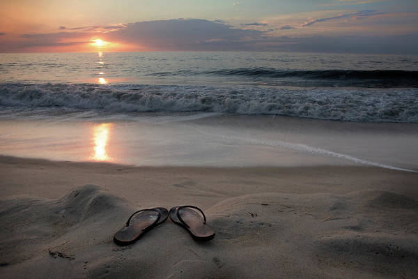 Water's Edge Art Print featuring the photograph Flip-flops On The Beach by Sdominick