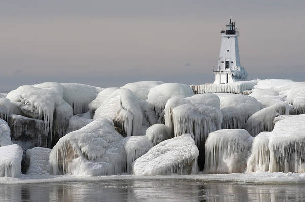 Water's Edge Art Print featuring the photograph Great Lakes Lighthouse With Ice Covered by Jskiba