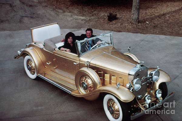 Mid Adult Women Art Print featuring the photograph Jack Smith In Gold Plated 1931 Cadillac by Bettmann