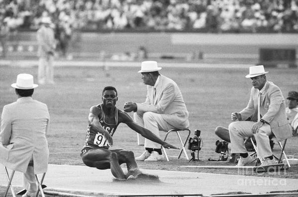 1980-1989 Art Print featuring the photograph Lewis In The Long Jump At Olympics by Bettmann
