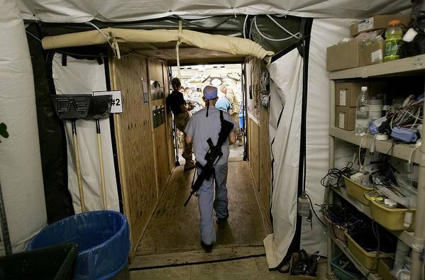 Rifle Art Print featuring the photograph Medical Personnel At Balad Trauma by Chris Hondros