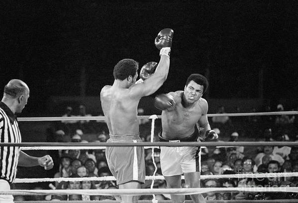 People Art Print featuring the photograph Muhammad Ali Punching George Foreman by Bettmann