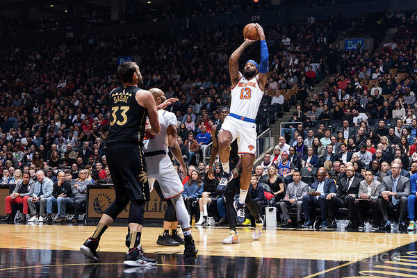 Nba Pro Basketball Art Print featuring the photograph New York Knicks V Toronto Raptors by Mark Blinch
