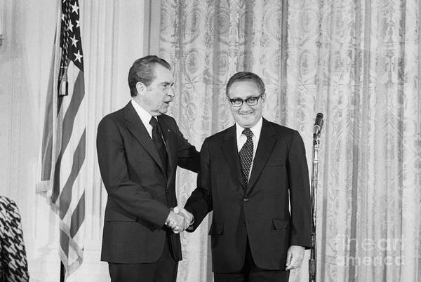 Mature Adult Art Print featuring the photograph Nixon Shakes Hands With Kissinger by Bettmann