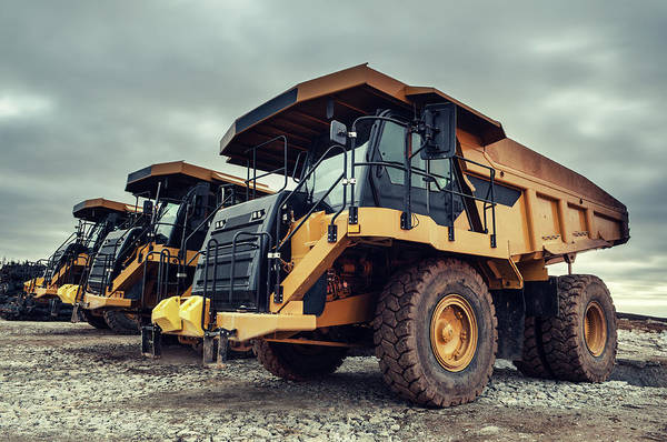 Construction Machinery Art Print featuring the photograph Off-highway Dump Trucks by Shaunl