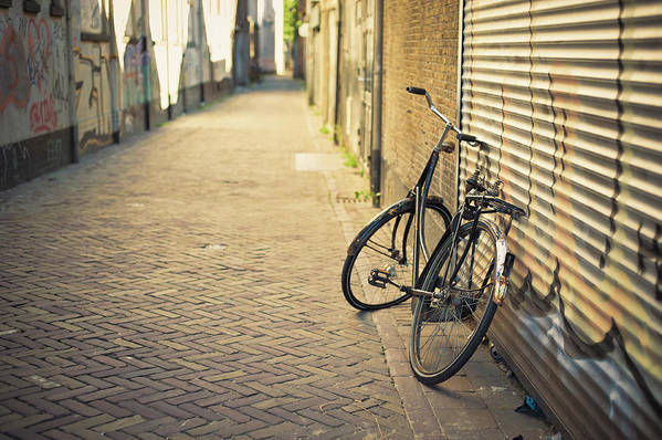 People Art Print featuring the photograph Old Abandoned Bicycle Leaning On The by Cirano83