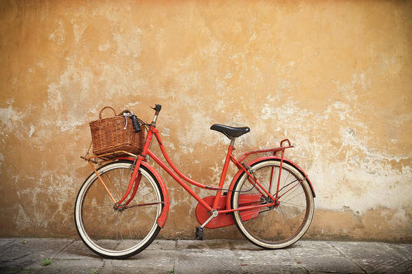 Leaning Art Print featuring the photograph Old Red Bike Against A Yellow Wall In by Romaoslo