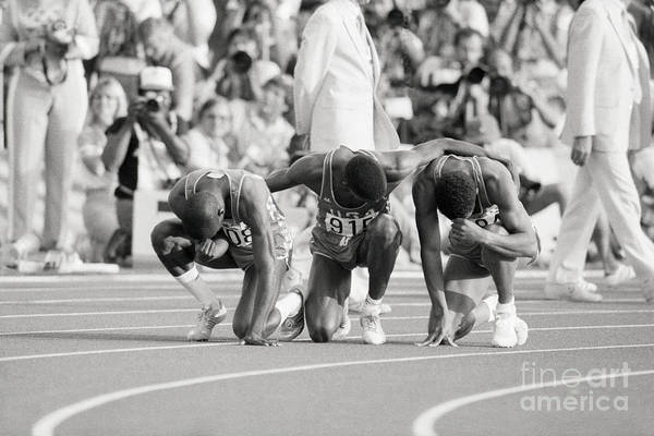 Thank You Art Print featuring the photograph Olympic Medal Winners Pray In Thanks by Bettmann