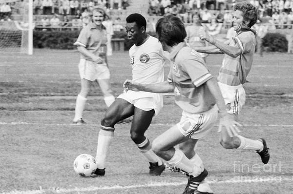 Pelé Art Print featuring the photograph Pele Running With Soccer Ball by Bettmann