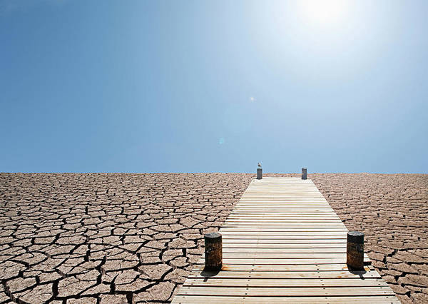 Environmental Damage Art Print featuring the photograph Pier Over A Dry Lake Bed by John Lund