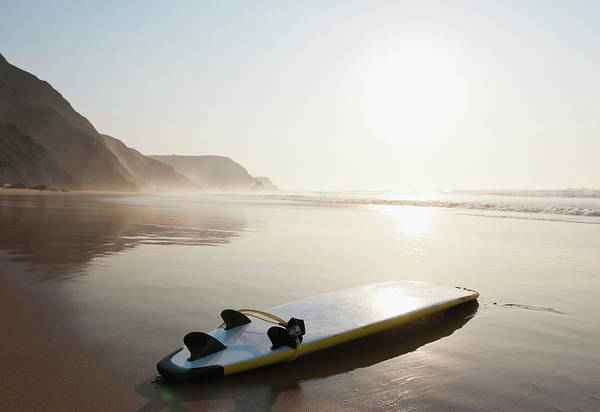 Algarve Art Print featuring the photograph Portugal, Surfboard On Beach by Westend61