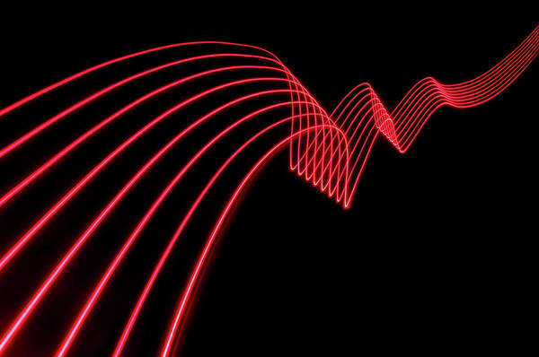 Laser Art Print featuring the photograph Red Abstract Coloured Lights Trails And by John Rensten