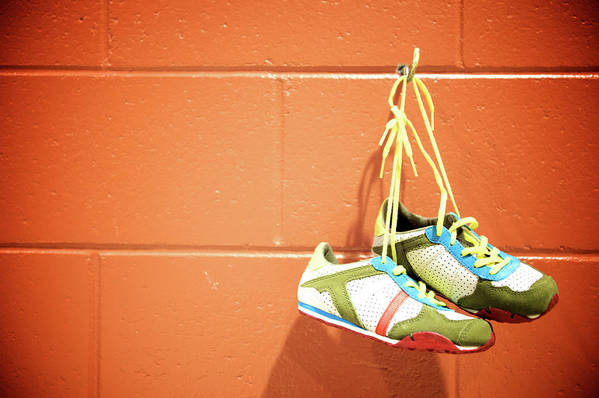 Hanging Art Print featuring the photograph Runnig Shoes Hanging On A Hook by Pascalgenest