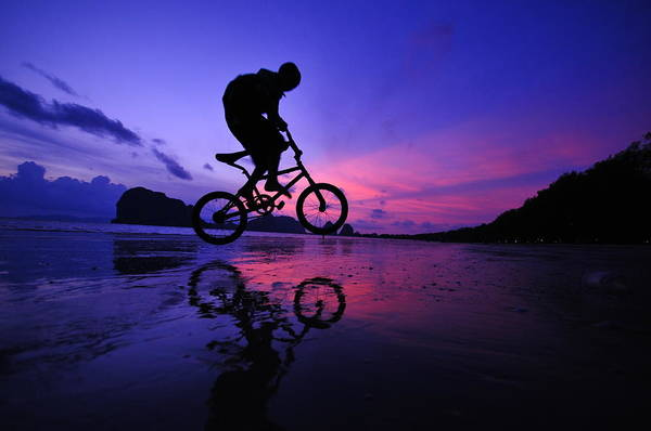 The Twilight Series Art Print featuring the photograph Silhouette Of A Mountain Biker On Beach by Primeimages
