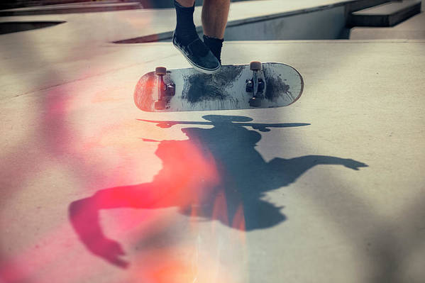 Cool Attitude Art Print featuring the photograph Skateboarder Doing An Ollie by Devon Strong