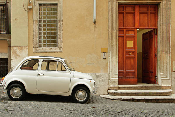Steps Art Print featuring the photograph Small Coupe Parked Near A Doorway On A by S. Greg Panosian