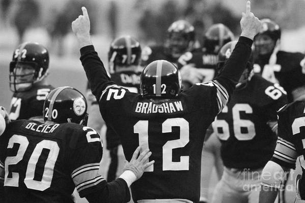 American Football Uniform Art Print featuring the photograph Terry Bradshaw With Arms Raised by Bettmann
