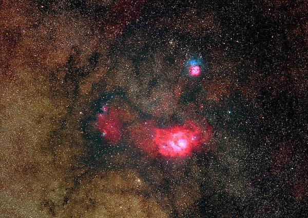 Sky Art Print featuring the photograph Trifid Nebulae And Lagoon Nebula by Imagenavi