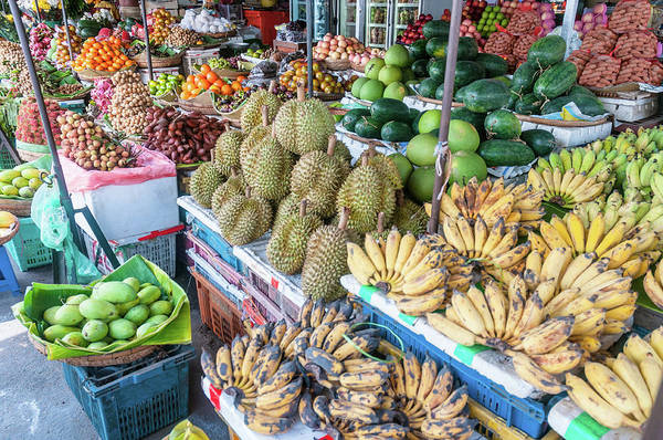 Mango Fruit Art Print featuring the photograph Tropical Fruit At A Street Market In by Tbradford