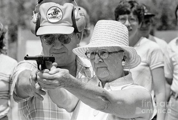 1980-1989 Art Print featuring the photograph Woman Practicing Firing A Gun by Bettmann