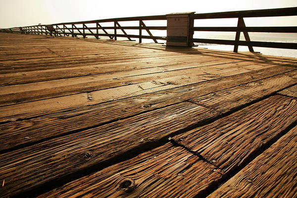 Scenics Art Print featuring the photograph Wooden Pier by Timnewman