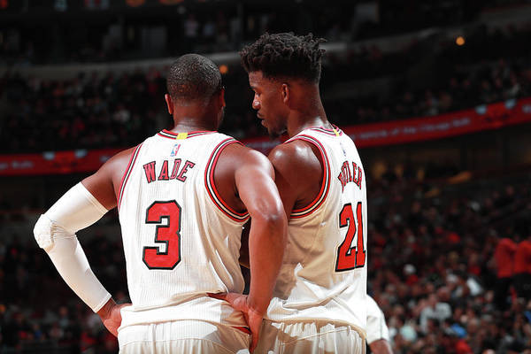Nba Pro Basketball Art Print featuring the photograph Jimmy Butler and Dwyane Wade by Jeff Haynes