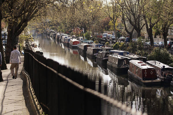 England Art Print featuring the photograph Londoners Enjoy The Warm Spring Weather by Oli Scarff