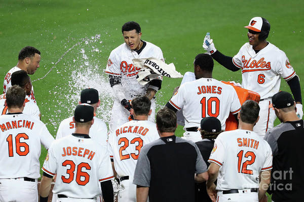 People Art Print featuring the photograph Manny Machado, Jonathan Schoop, and Adam Jones by Rob Carr