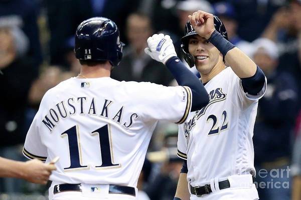 People Art Print featuring the photograph Mike Moustakas and Christian Yelich by Dylan Buell