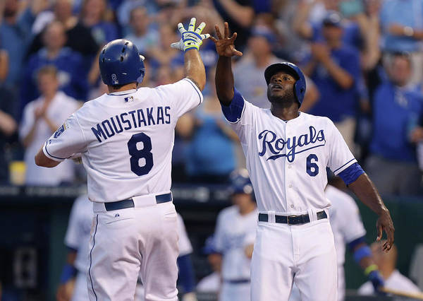 American League Baseball Art Print featuring the photograph Mike Moustakas And Lorenzo Cain by Ed Zurga