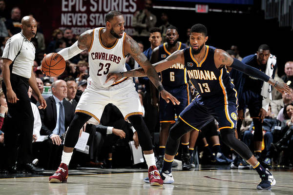 Nba Pro Basketball Art Print featuring the photograph Paul George and Lebron James by David Liam Kyle
