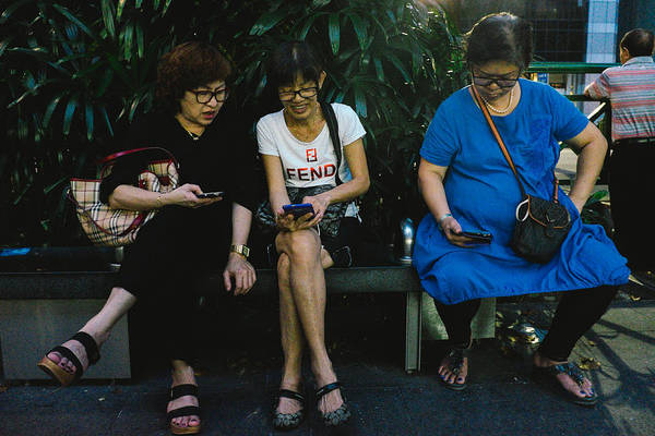 Telephone Art Print featuring the photograph People Using Cellphones by Neo Chee Wei
