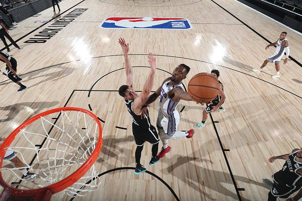 Nba Pro Basketball Art Print featuring the photograph Sacramento Kings v Brooklyn Nets by David Sherman