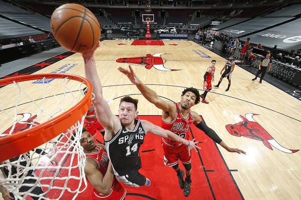 Nba Pro Basketball Art Print featuring the photograph San Antonio Spurs vs. Chicago Bulls by Jeff Haynes