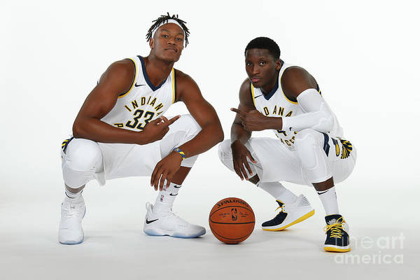 Media Day Art Print featuring the photograph Victor Oladipo and Myles Turner by Ron Hoskins
