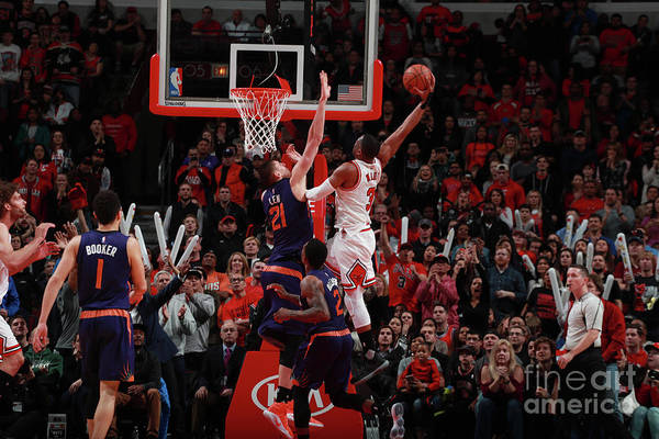 Nba Pro Basketball Art Print featuring the photograph Alex Len and Dwyane Wade by Jeff Haynes