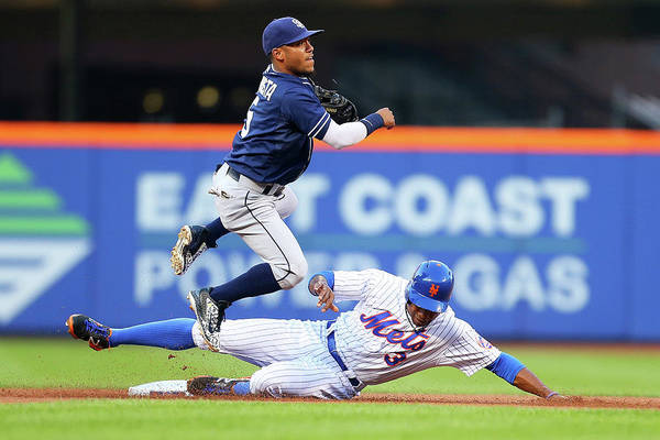 Double Play Art Print featuring the photograph Alexi Amarista And Curtis Granderson by Mike Stobe