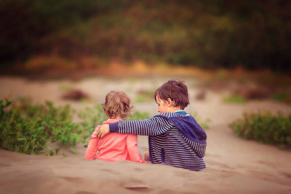 Child Art Print featuring the photograph Beach hugs by Sarahwolfephotography