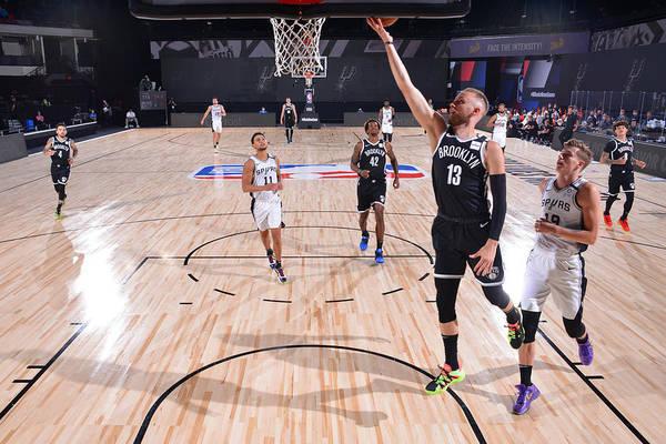 Nba Pro Basketball Art Print featuring the photograph Brooklyn Nets v San Antonio Spurs by Jesse D. Garrabrant