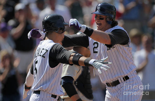 Scoring Art Print featuring the photograph Carlos Gonzalez and Troy Tulowitzki by Doug Pensinger