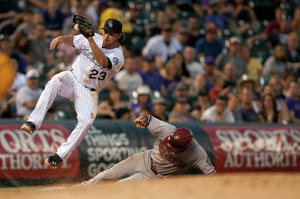 Catching Art Print featuring the photograph Charlie Culberson and Martin Prado by Dustin Bradford