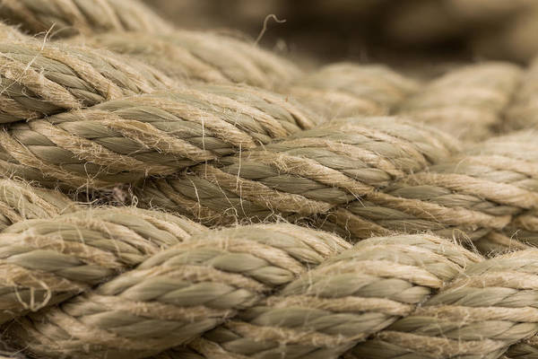 Fiber Art Print featuring the photograph Close-up of an old frayed boat rope as a background by R.Tsubin