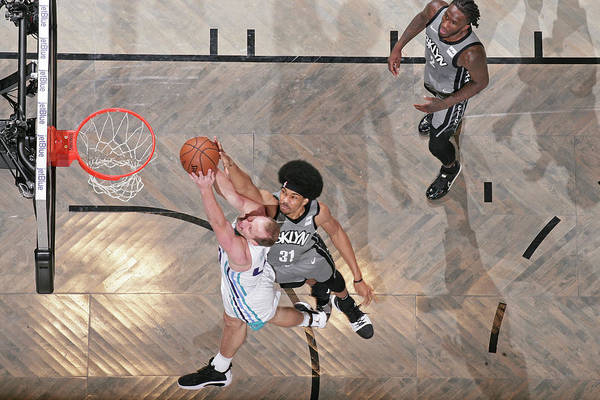 Nba Pro Basketball Art Print featuring the photograph Cody Zeller and Jarrett Allen by Nathaniel S. Butler